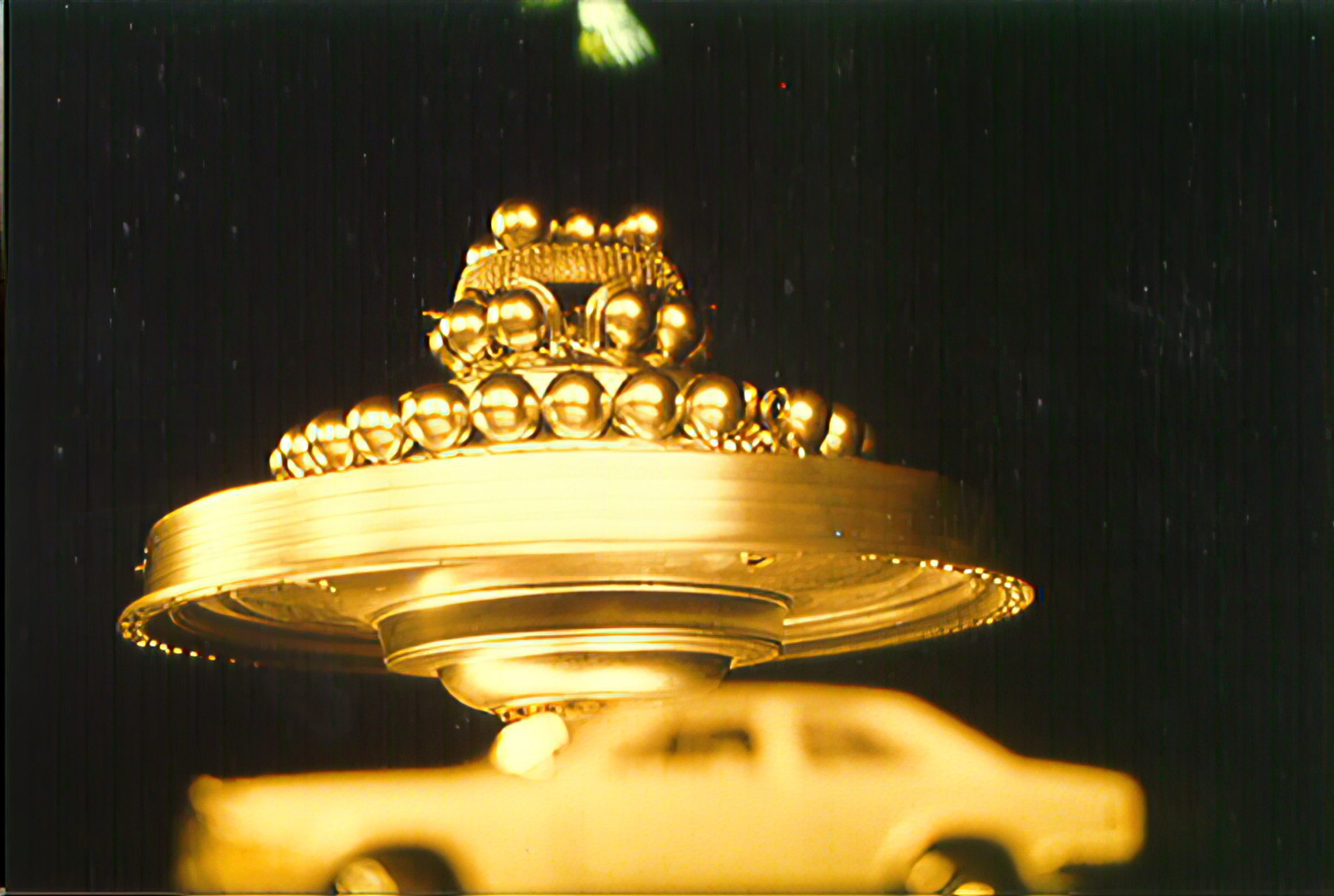 WCUFO - Gold Appearance with Car